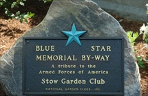 Plaque embedded in large rock  - Shows a large blue star and says Blue Star Memorial Byway - and that plaque presented by Stow Garden Club