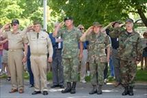 Members of uniformed military personnel saluting
