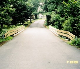 Hiley Brook Road Bridge - view from driver's seat with wooden guardrails on both sides